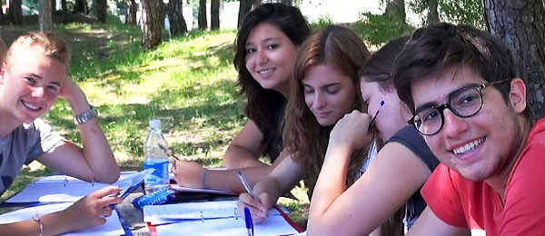 Italian Language Programme in Lignano, students during a lesson sitting around a table outdoors