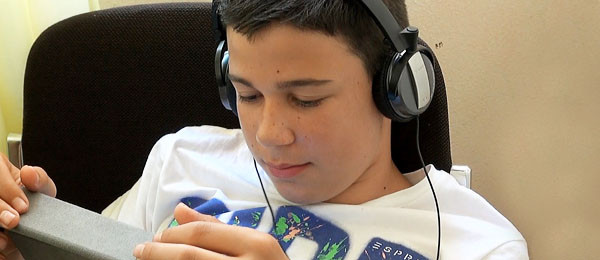 Residential Accommodation in Lignano, young student relaxing with headphones