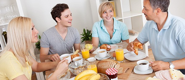 Homestay in Milan, family having breakfast with student